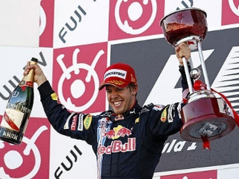 Vettel vence e Barrichello só chega em sétimo